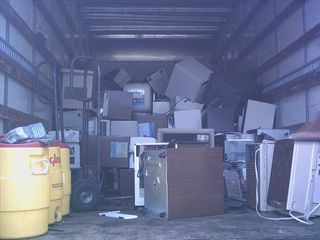 truck full of old dehumidifiers and air conditioners
